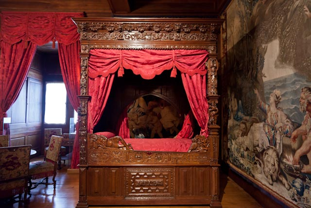 Tapestries and carved wood decorate a royal bedroom in the Château de Pau.